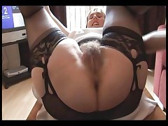 Hairy huge-boobed mature lady in slip and girdle does upskirt and